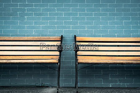 empty two wooden bench on green