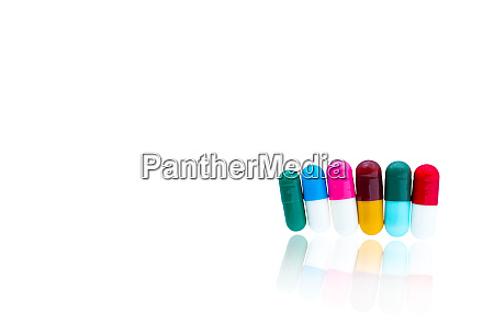colorful capsule pills in a row