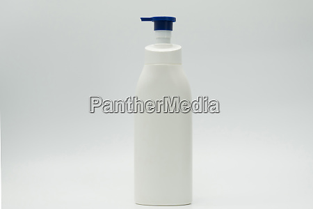 cosmetic white plastic bottle with blue