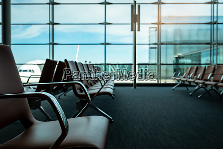 passenger seats in departure lounge at