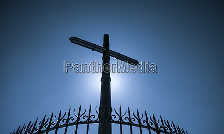 stainless steel cross and fence on