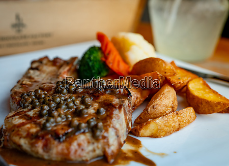 selective focus on steak topped with