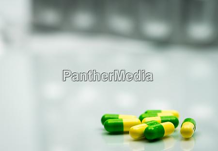green yellow tramadol capsule pills on