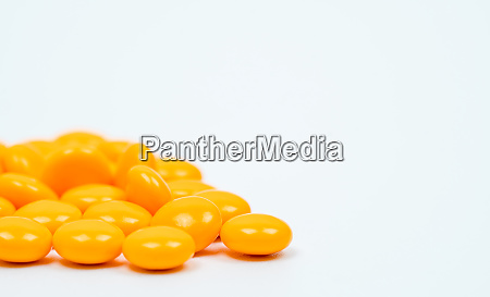 yellow sugar coated tablets pills on