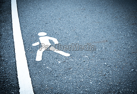 white painted sign on asphalt people