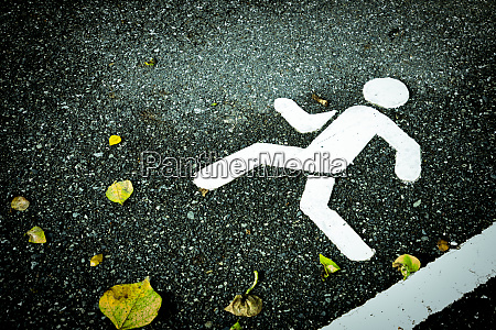 white painted sign on asphalt pedestrian