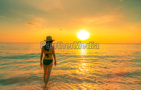 silhouette sexy woman walking at tropical