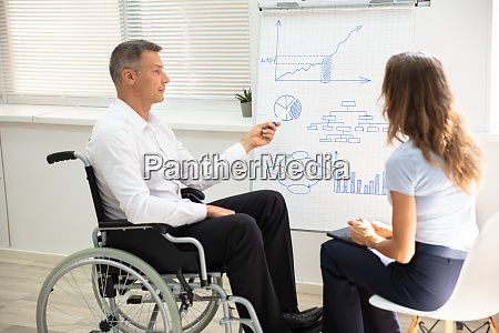 disabled businessman giving presentation to his