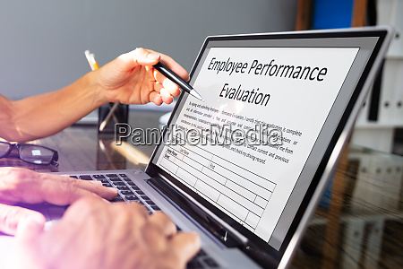 businessman filling employee performance evaluation form