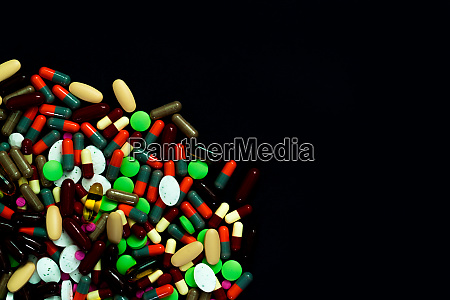 pile of colorful tablets and capsules