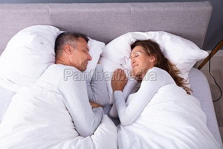couple sleeping on bed