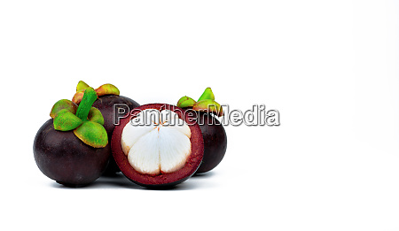 three whole purple mangosteen and another