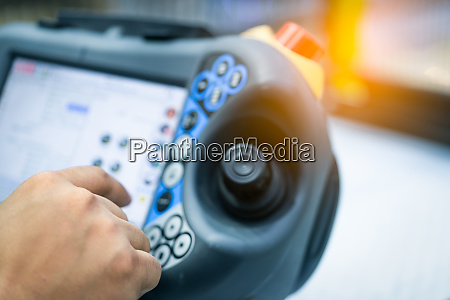 engineer hand point at control button