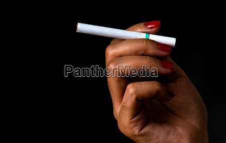 cigarette in woman hand with red