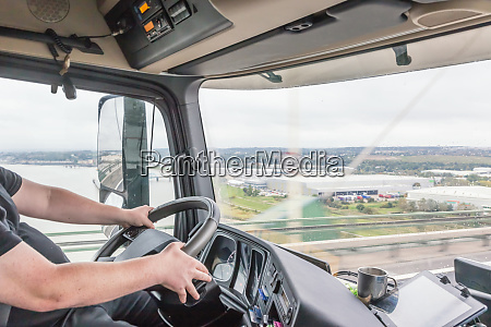 view of truck driver in interior