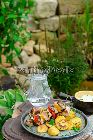 outside grilling shish kebab