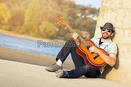 singing guy playing guitar