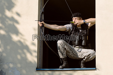 archer aiming bow and arrow