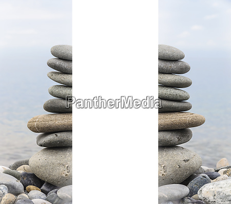 pyramid of sea stones on pebbles
