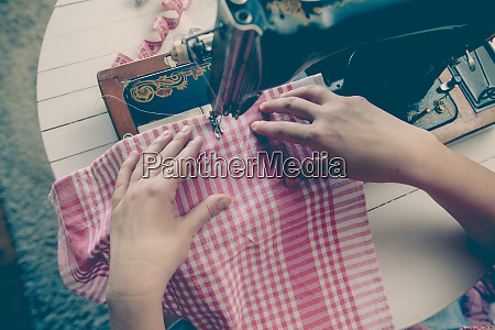 woman tailor working with old