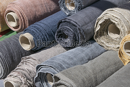 rolls of linen canvas textile on