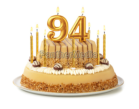 festive cake with golden candles
