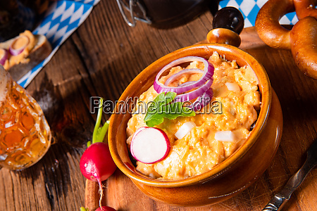 rustic bavarian obazda with radishes and