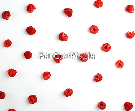 red ripe raspberries scattered on a