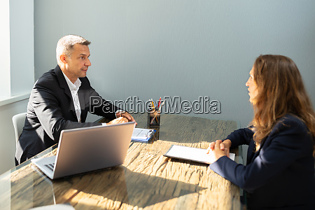 businessman taking an interview of woman
