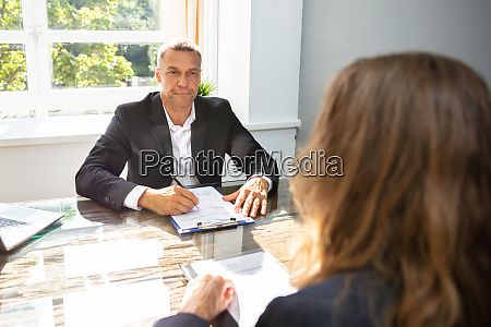 businessman interviewing female applicant