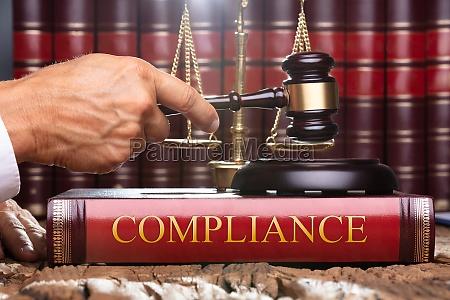 judge gavel and soundboard on compliance