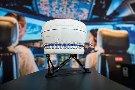 flight simulator model in front of