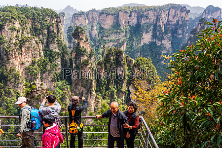 senior tourists taking pictures in wulingyuan