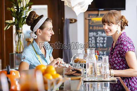 woman buying fresh cookies in bakery