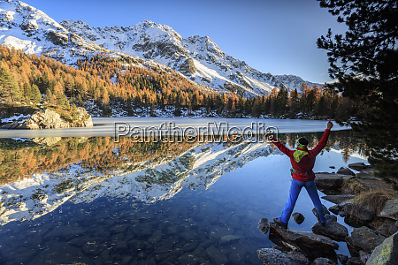 hiker rejoices in the colourful autumnal