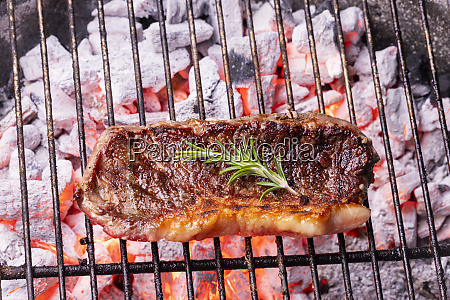 glowin charcoal with a beef steak