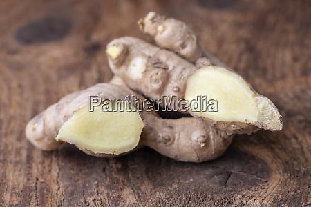 fresh ginger on dark wood