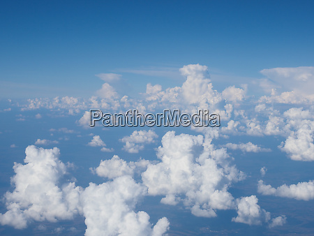 blue sky with clouds background seen