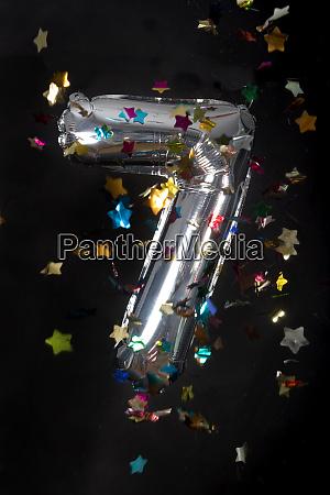 silver balloon and confetti for 7th
