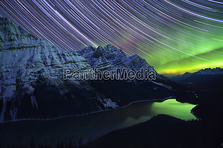 star trails and northern lights over