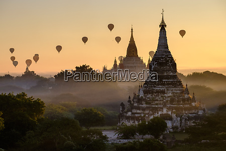 hot air balloons over buddhist temples