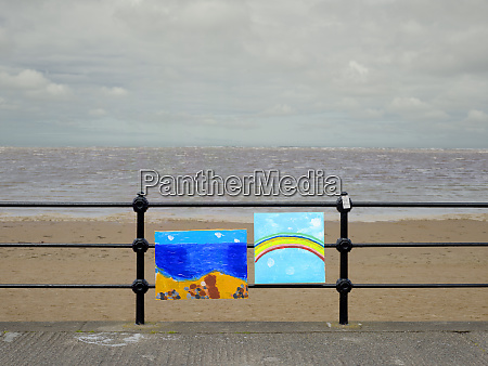 optimistic paintings tied to railings on