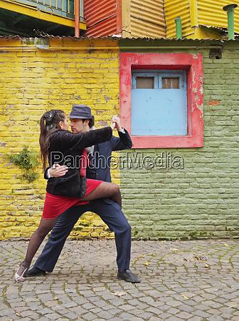 couple dancing tango on caminito street