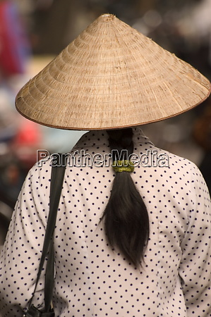 long hair lady wearing conical hat