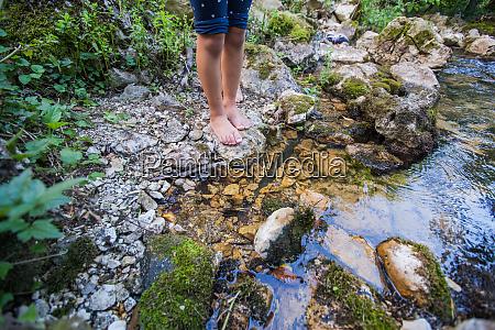 children adventure at forest creek in