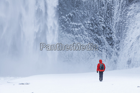 one person in red jacket walking