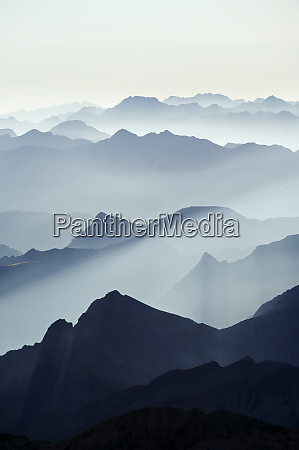mountains silhouetted at sunrise view from