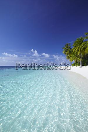 tropical island and lagoon ari atoll