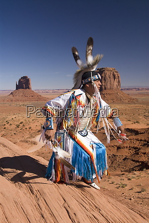 navajo man dressed in traditional costume