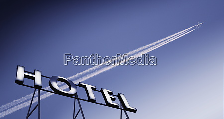 plane in blue sky with vapour